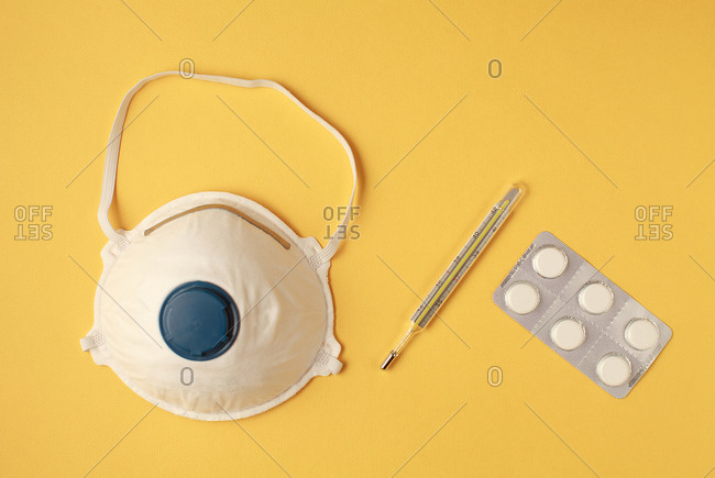 face mask or dust mask or respirator, pills and thermometer - corona virus covid19