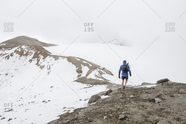 Ona man walks at the summit of Iztaccihuatl Volcano in Mexico.