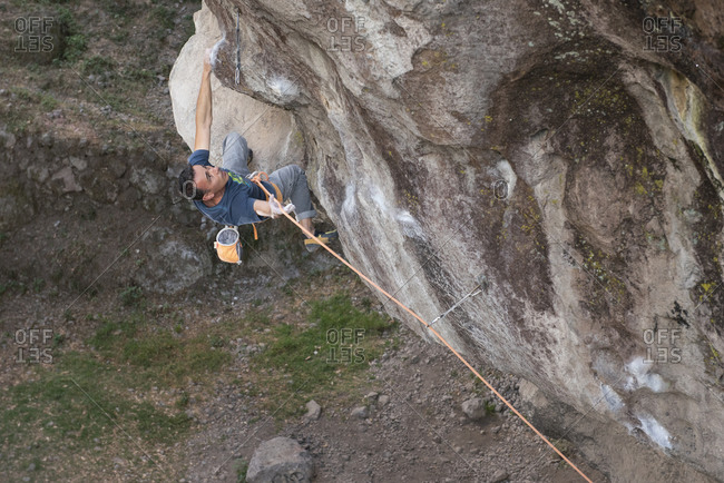 One man holding a rope while rock climbing in Jilotepec, Mexico