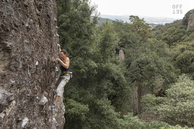 One woman rock climbing in Jilotepec, Mexico