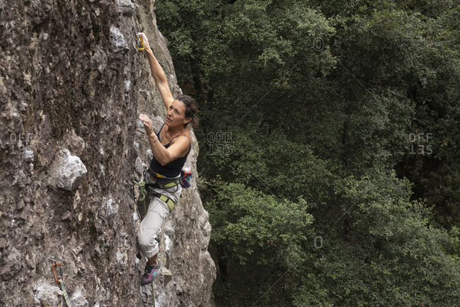Woman rock climbing in Jilotepec, Mexico.