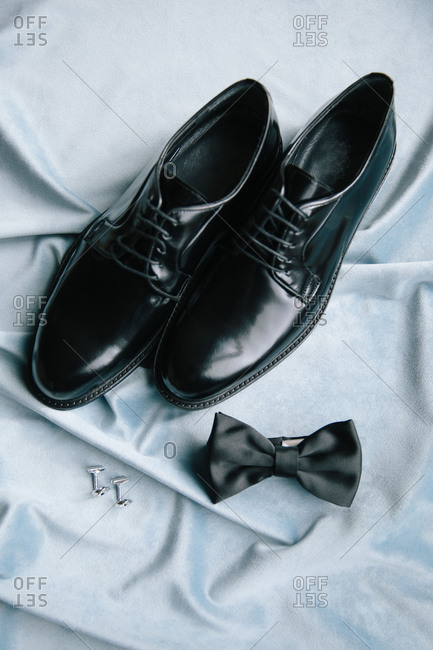 Groom accessories. Shoes, bow tie, and cufflinks.