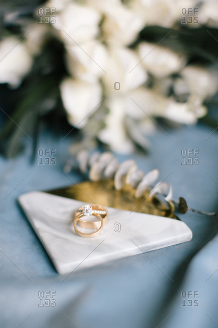 Diamond rings and wedding rings. On the blue background.