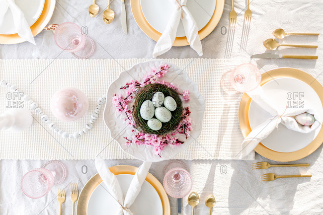 overhead shot of easter tablescape with cherry blossoms