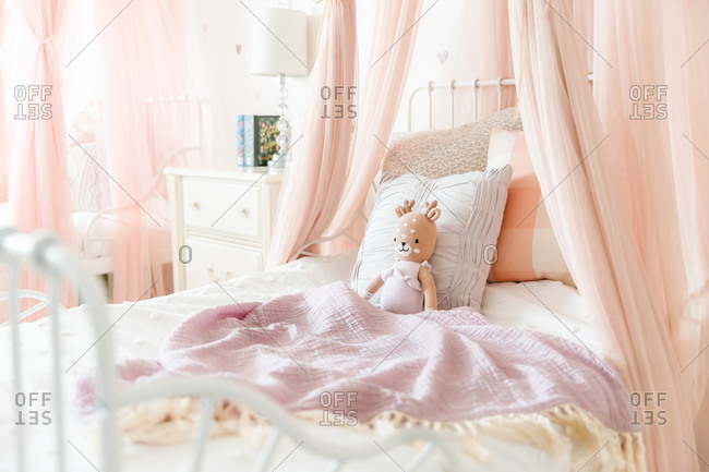 Little girl bed with stuffed animal