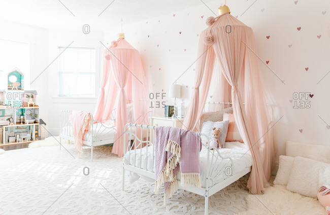 A sister room with pink canopies