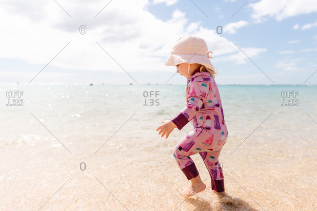 Toddler girl playing in the ocean