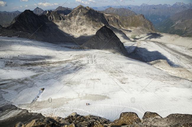 Hikers cross Snowbird Glacier, Talkeetna Mountains, Alaska