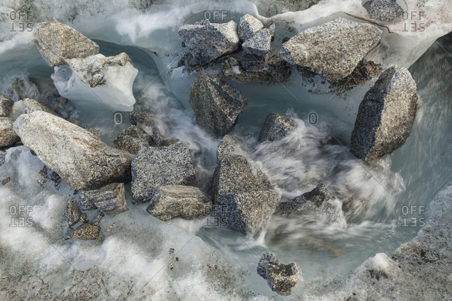 Meltwater stream on Snowbird Glacier, Talkeetna Mountains, Alaska