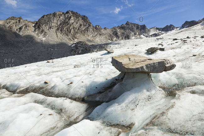 Balanced rock on Bomber Glacier, Talkeetna Mountains, Alaska
