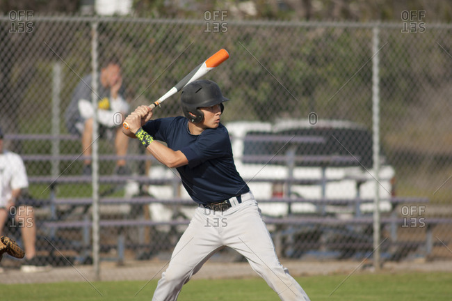 Teen baseball player ready to swing in the batters box