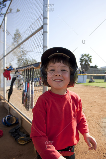 Young boy smiling near the TBall dugout