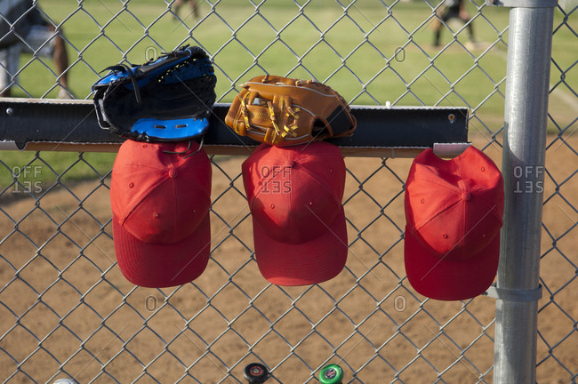 Hats and gloves hanging in a TBall dugout