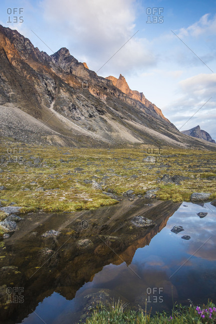 Reflection of alpenglow on mountains in Akshayak Pass, Baffin Island.