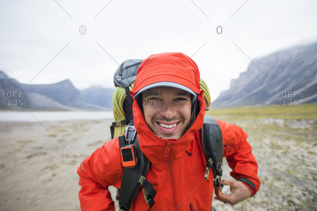 Portrait of happy backpacker in remote location.