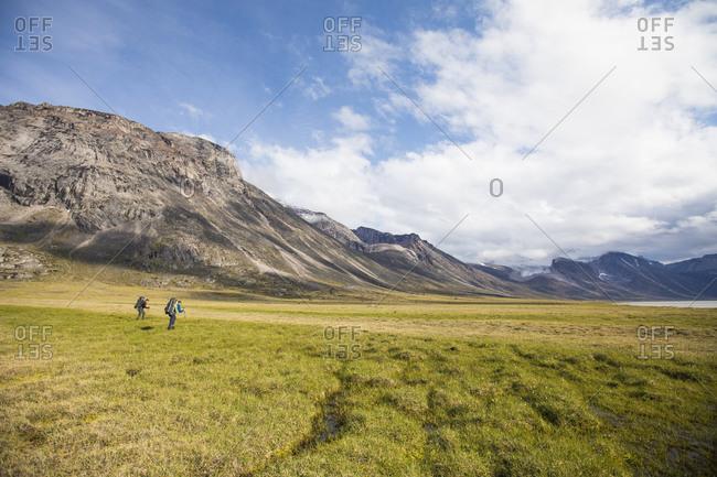 Backpackers hiking in Akshayak Pass, Auyuittuq National Park.