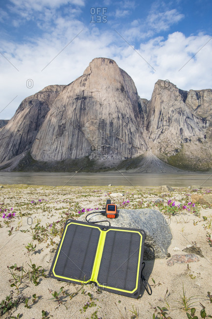GPS charging via solar panel under beautiful mountain scene