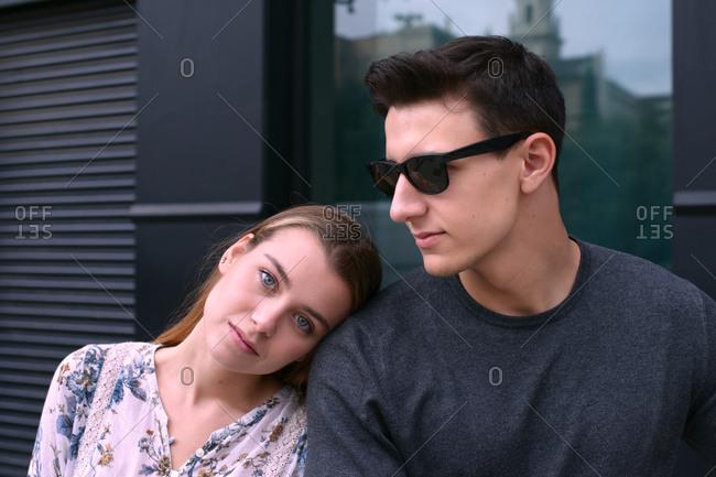 Boyfriend and girlfriend lean on each other