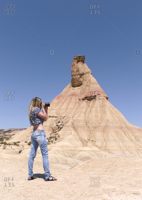 Young woman photographer in the nature reserve in Spain, Navarra