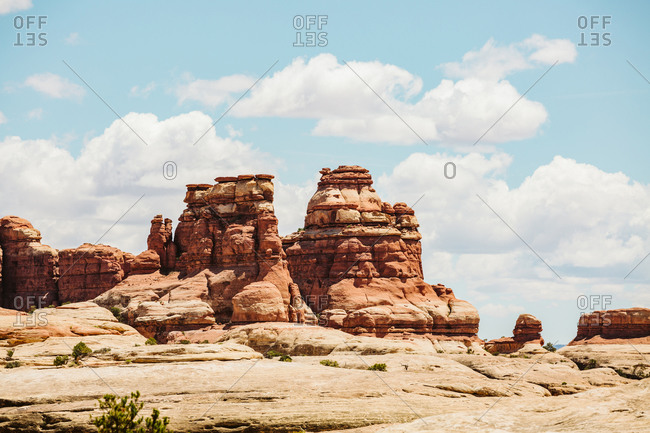 Layered red sandstone towers on a sunny day in the maze Utah