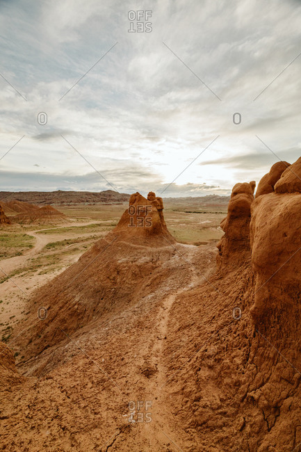 Path winds through a moody desert in goblin valley state park Utah