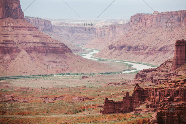 Red sandstone canyon walls and the Colorado river near Moab Utah
