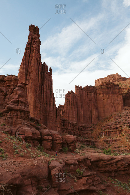 Hiker heads down path under the fisher towers near Moab Utah