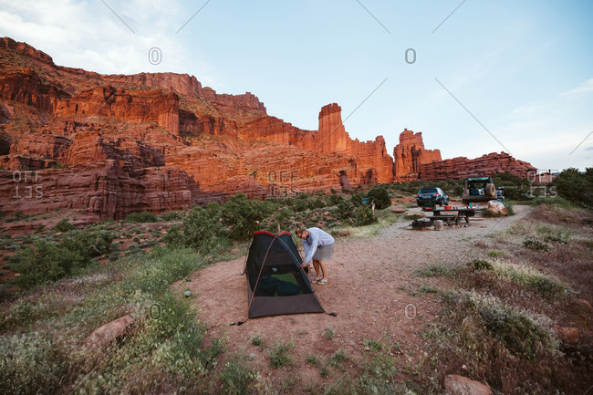 Woman sets up camp under the fisher towers near Moab Utah