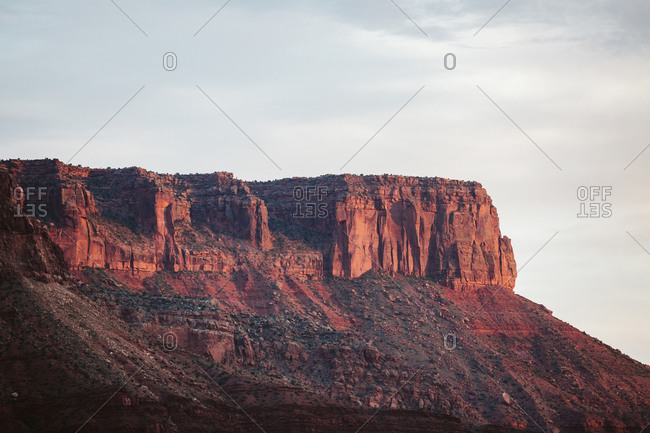 Red sandstone and vermillion cliffs at dusk near Moab Utah