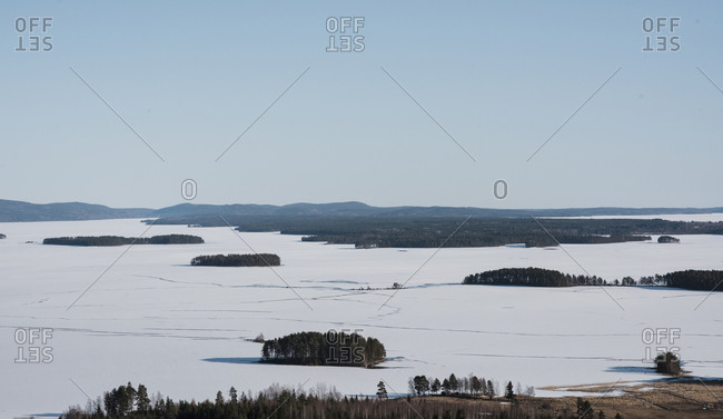 View over the mountains and the frozen Baltic sea in northern Sweden