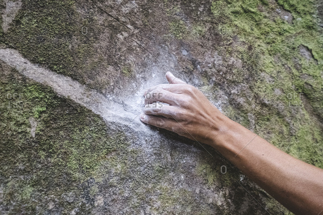 Close up of a rock climber hand on rock