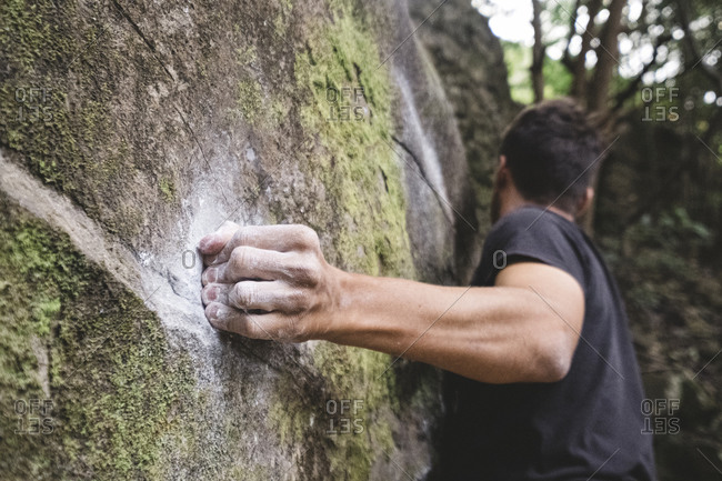 Close up of a rock climber hand on a rock