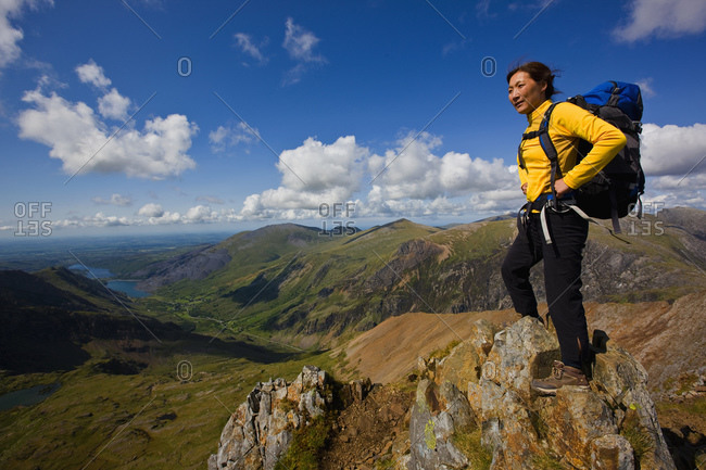 Woman with rucksack overlooking Snowdonia national park