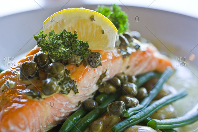 Close up of salmon with capers and lemon