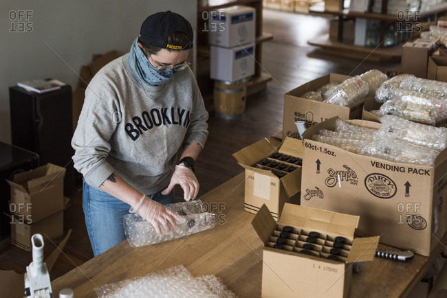 Brooklyn, New York, USA - April 24, 2020: Bottles of hand sanitizer being shipped by Kings County Distillery. The Distillery that usually produces whiskey has converted it's operations to the production of hand sanitizer.
