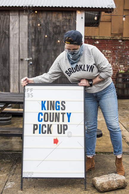 Brooklyn, New York, USA - April 24, 2020: Kings County Distillery hand sanitizer and whiskey pick up inside the gatehouses at Kings County Distillery.