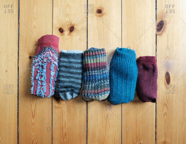 Pairs of matched socks folded on hardwood floor