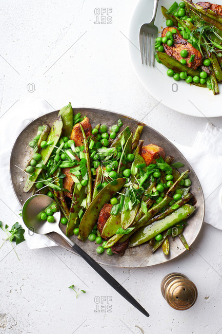 Healthy dinner with chicken stir-fry with snow peas and green beans in miso sauce