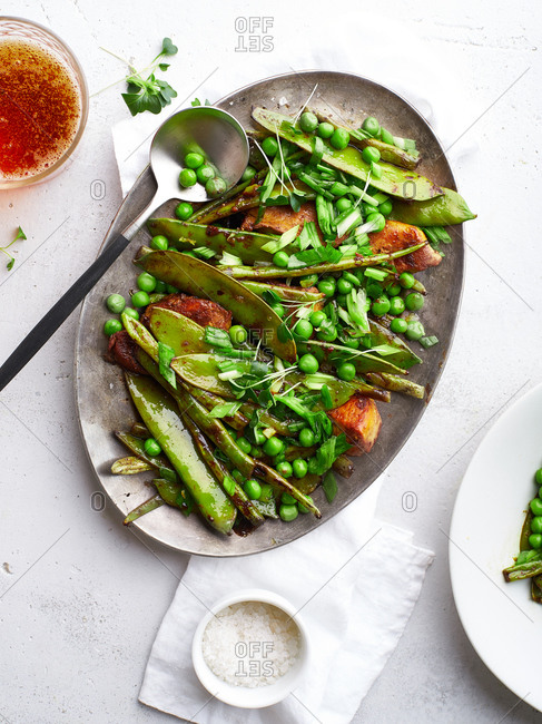 Top view of chicken stir-fry with snow peas and green beans in miso sauce
