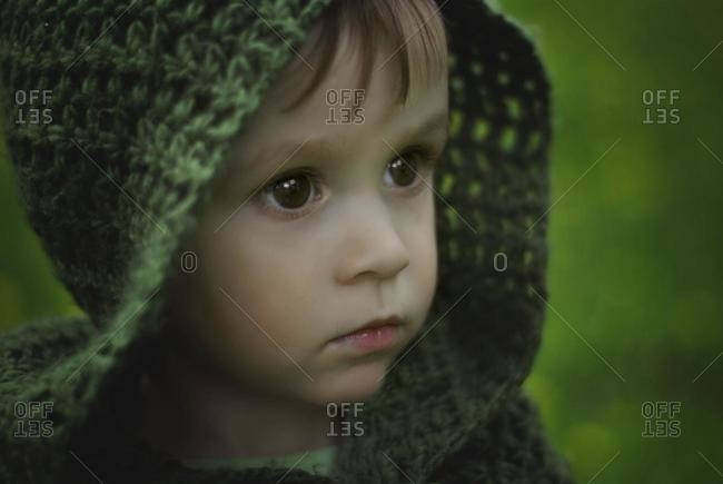 Portrait of a boy wearing a green hood, Poland
