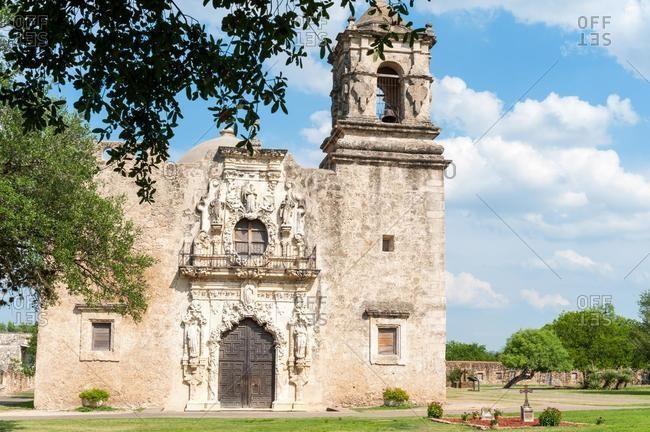 Facade and formal gardens of Mission San Jose, San Antonio, Texas, USA