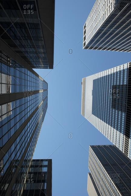 Low angle view of skyscrapers, Manhattan, New York, USA