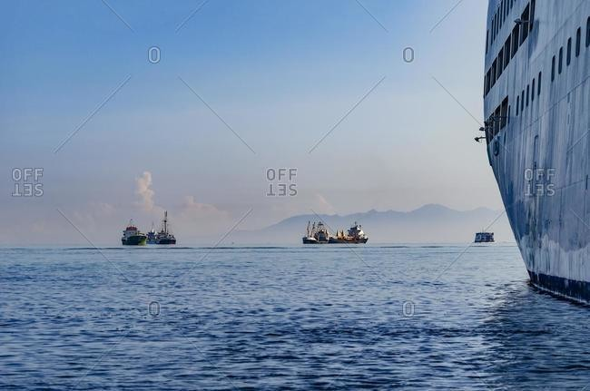 Tankers and ships sailing in ocean, Indonesia