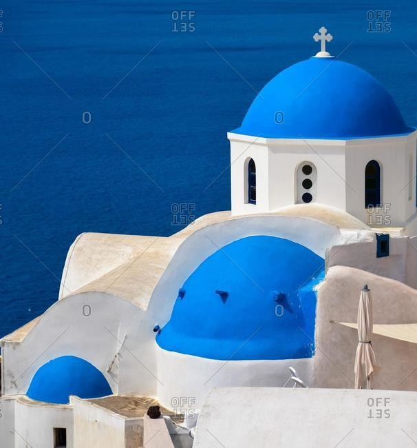 Orthodox church dome and rooftops, Santorini, Cyclades Islands, Greece