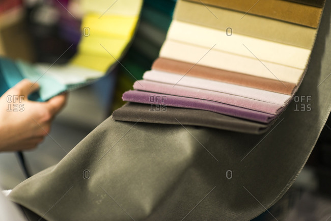 An interior designer looks at color swatches