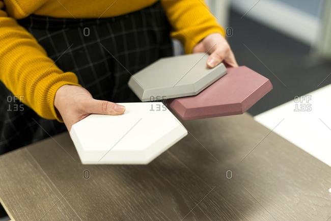 An interior designer looks at tiles