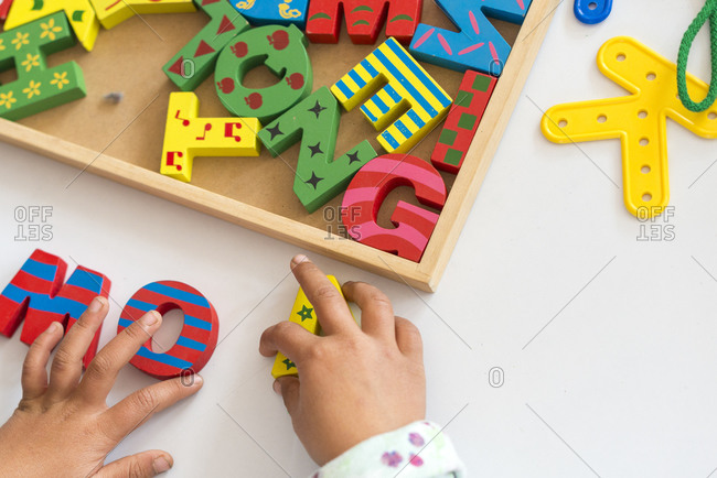 Child playing with letters in a classroom