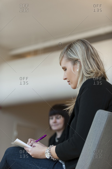 Helsinki, Finland - September 5, 2012: A business student at Aalto University taking notes