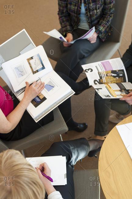 Helsinki, Finland - September 5, 2012: Business students at Aalto University in Helsinki in a meeting