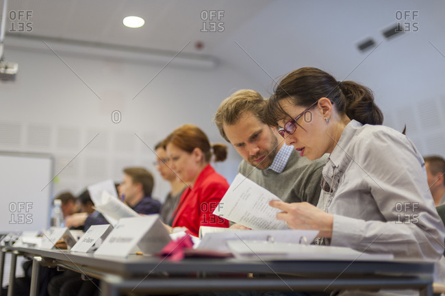 Helsinki, Finland - September 5, 2012: Business students at Aalto University in Helsinki discuss notes in a classroom